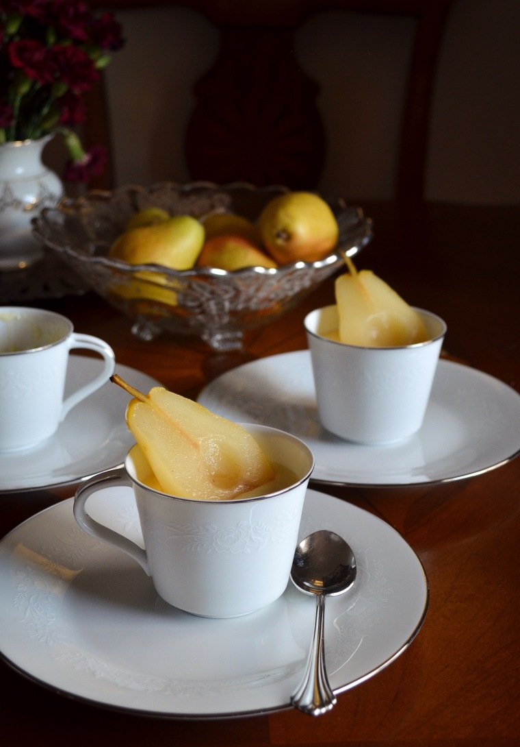 Poached pears with custard